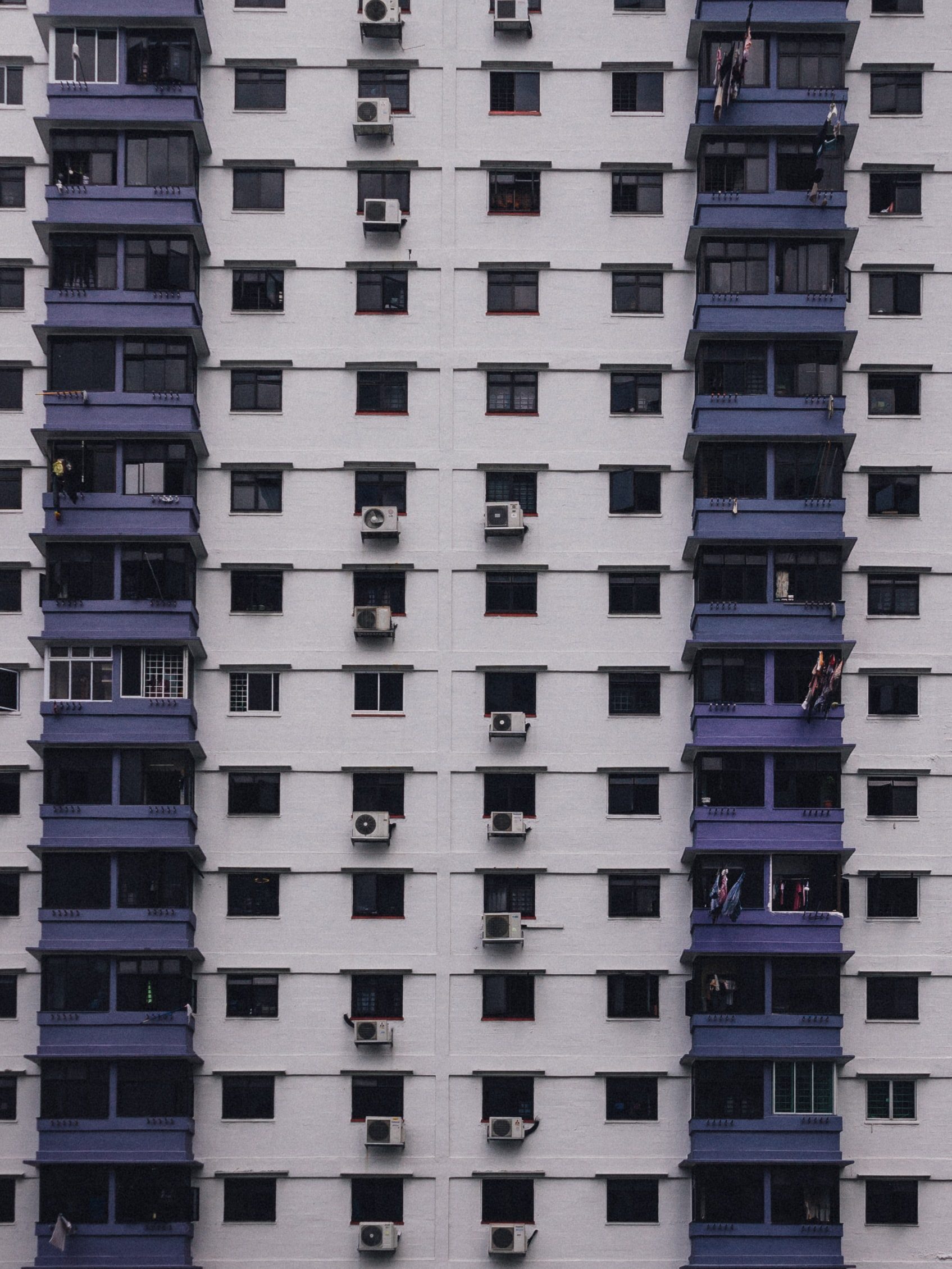 white and purple concrete high-rise building view during daytime