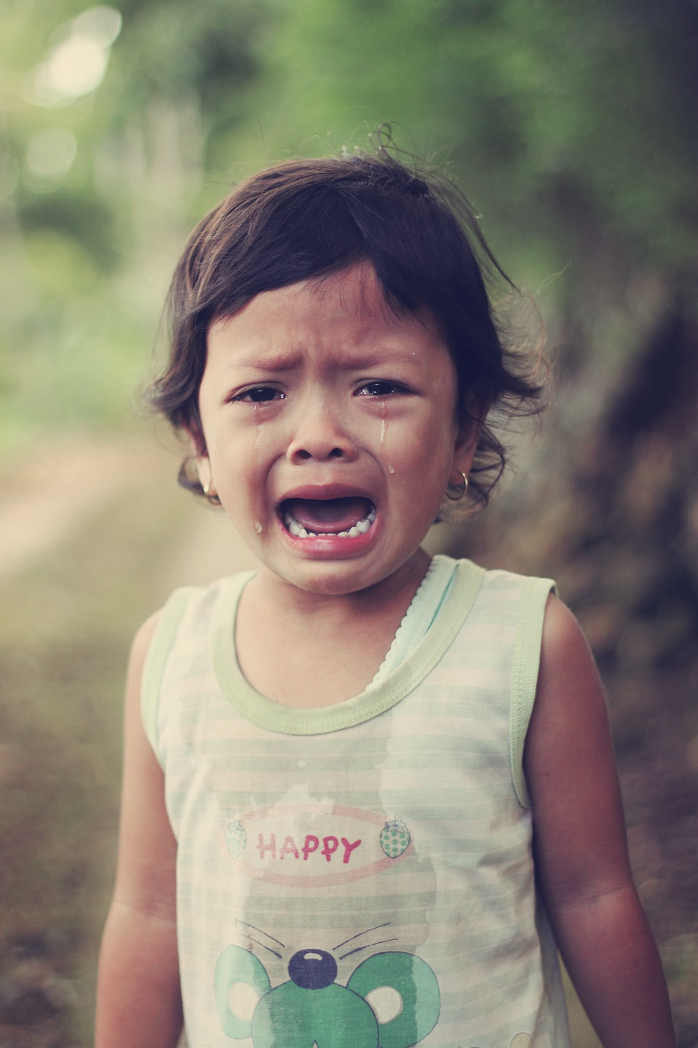 selective focus photography of girl crying