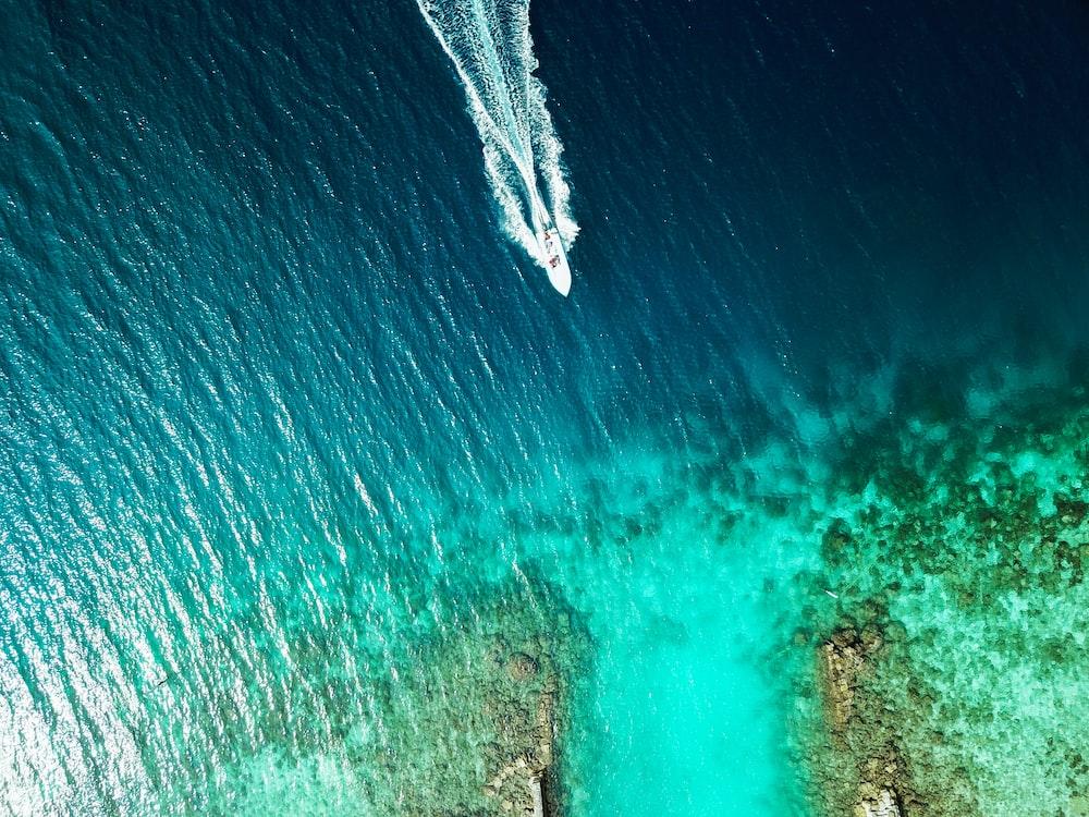 boat moving toward island