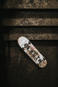 white skateboard beside stairs