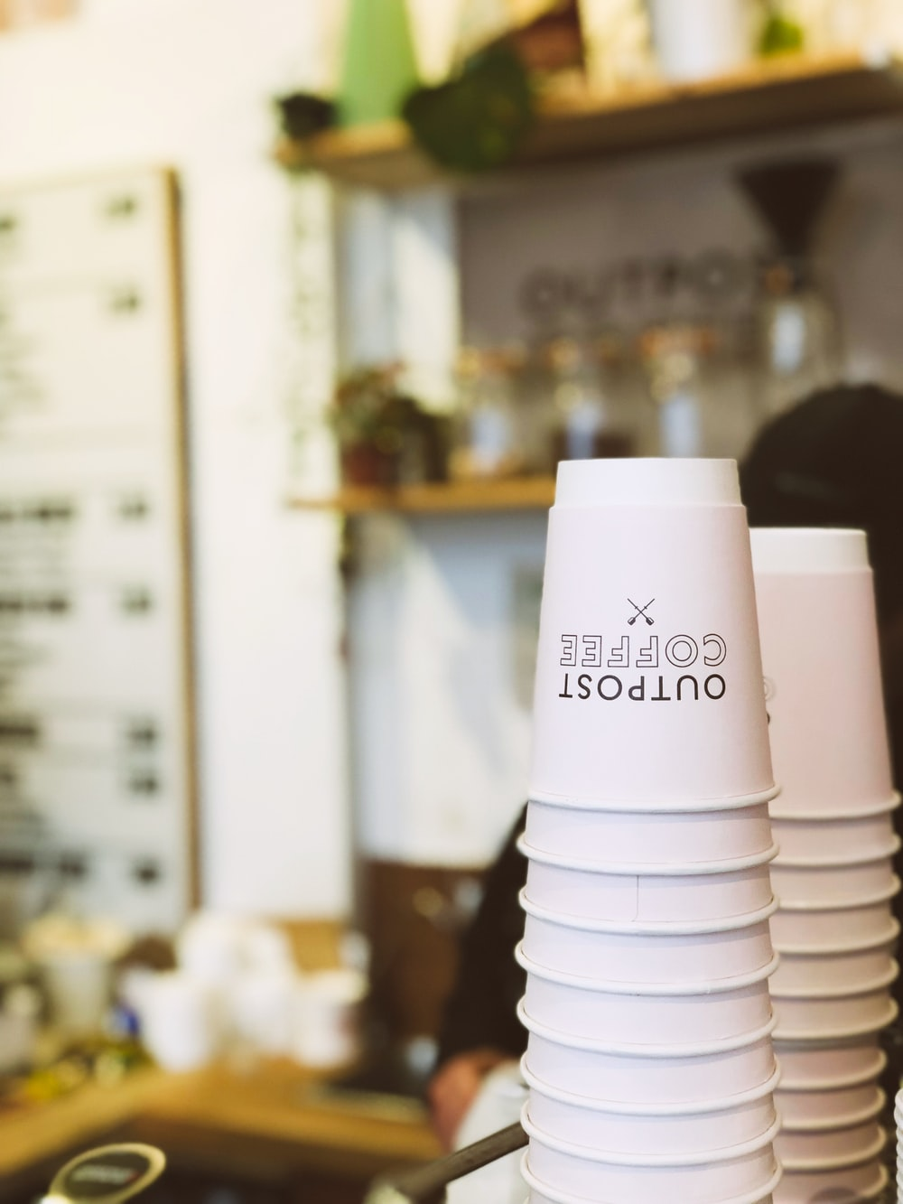 white disposable coffee cups