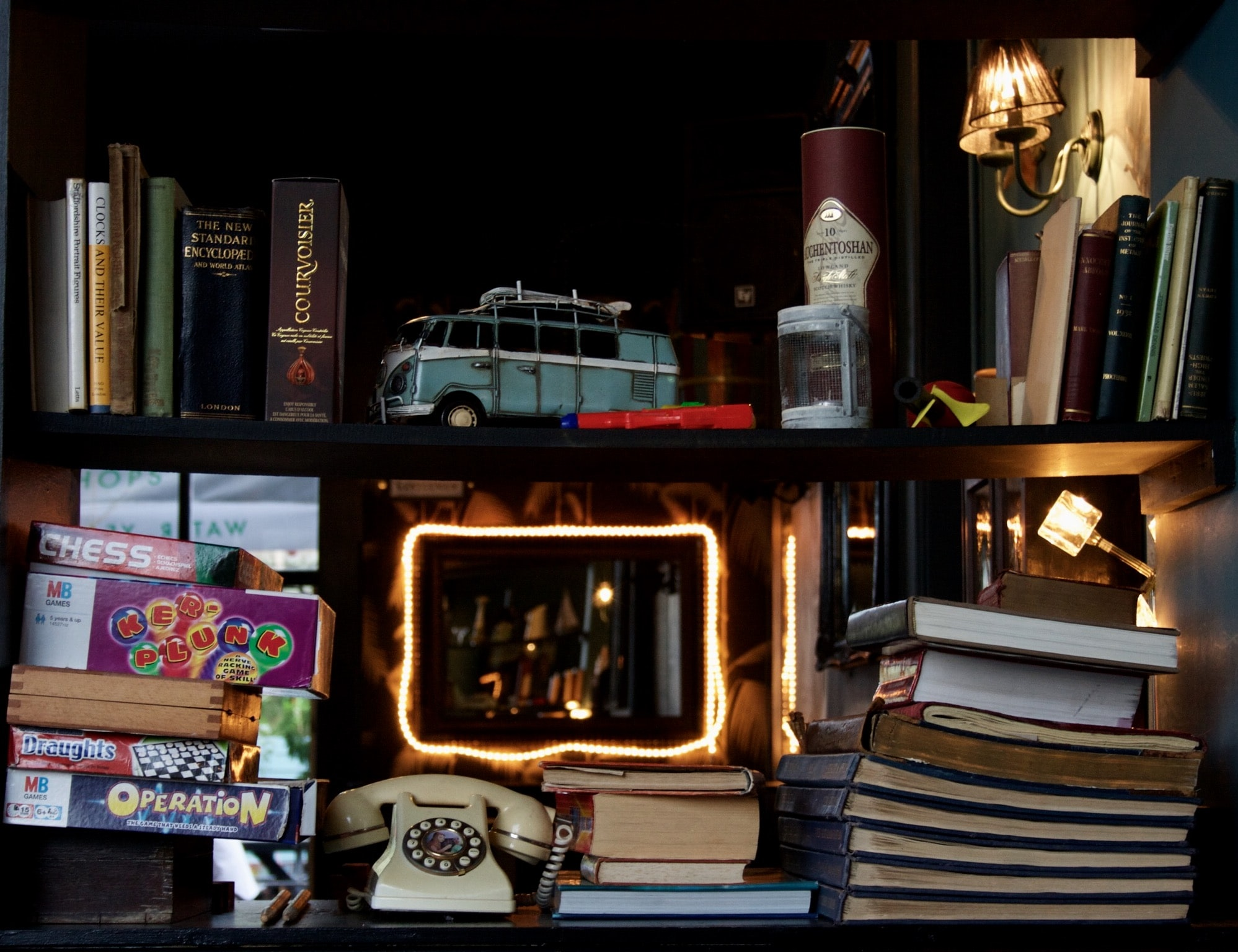 blue van on brown wooden shelf