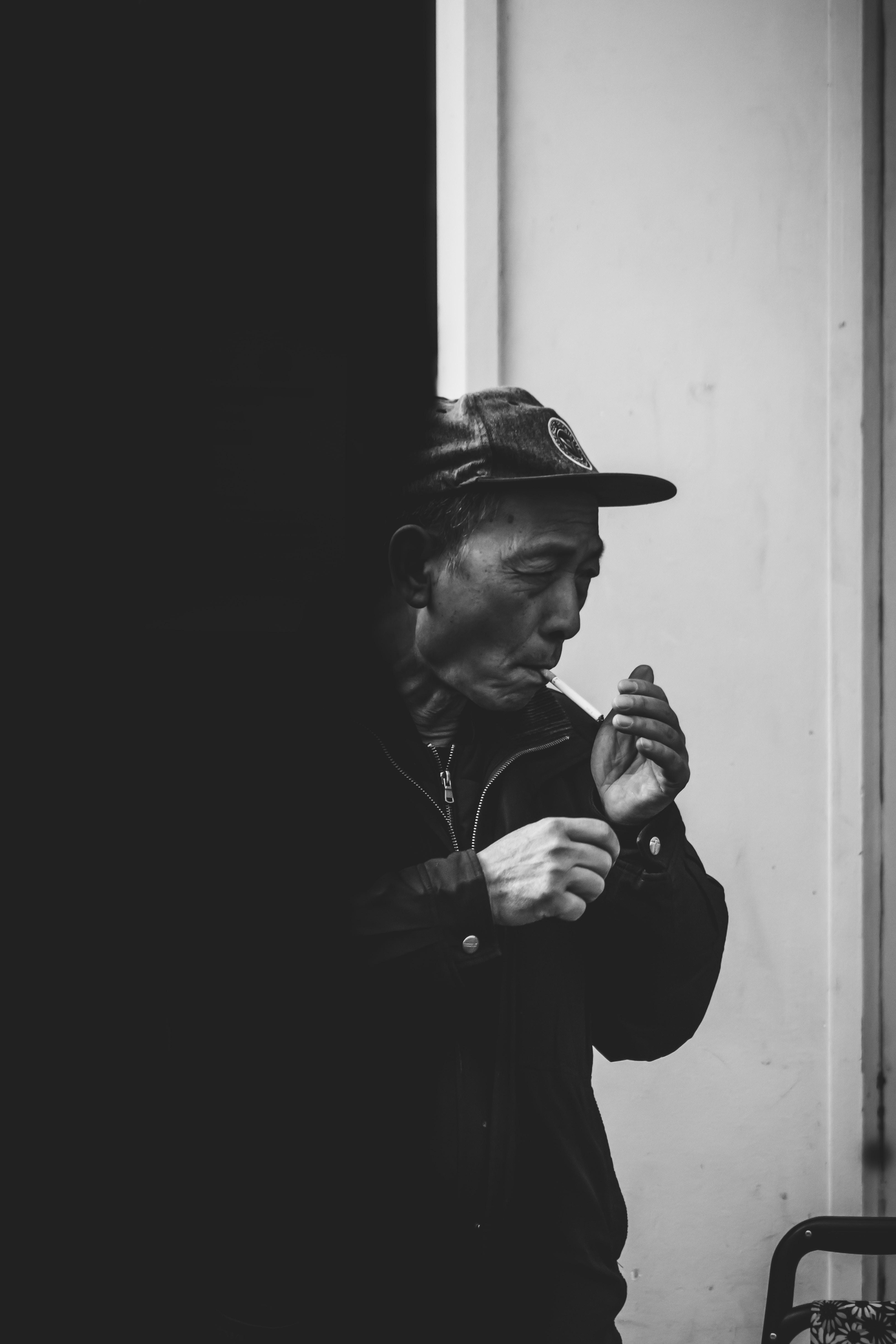 man lighting cigarette stick