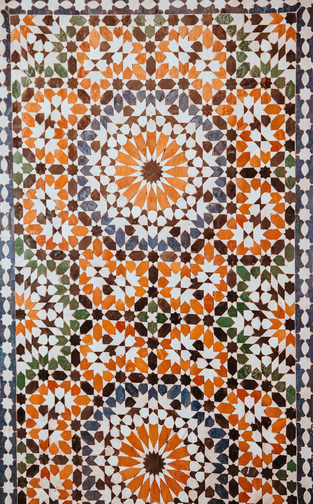 closeup photo of white, orange, and gray area rug