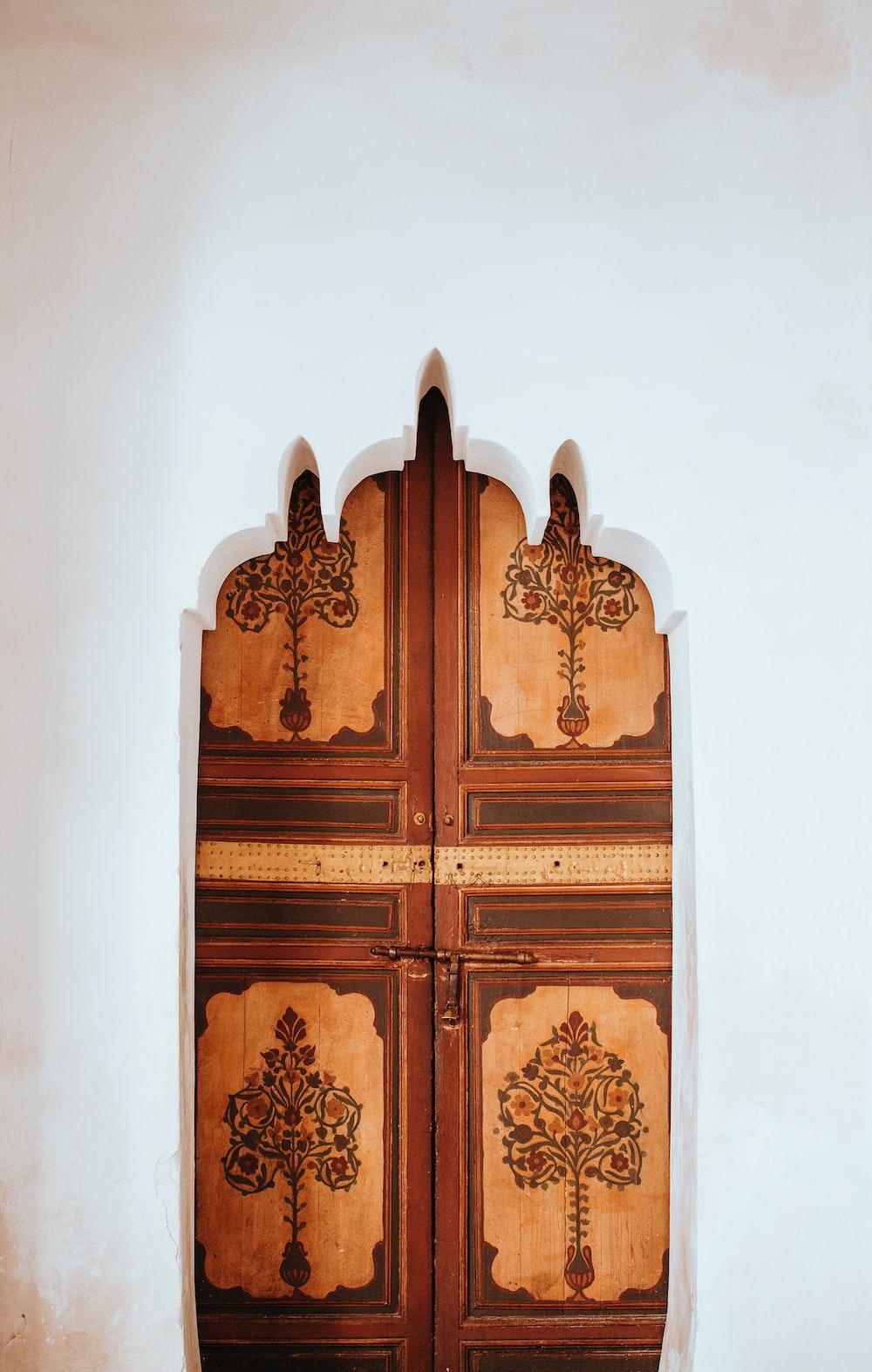 brown and beige wooden floral doors