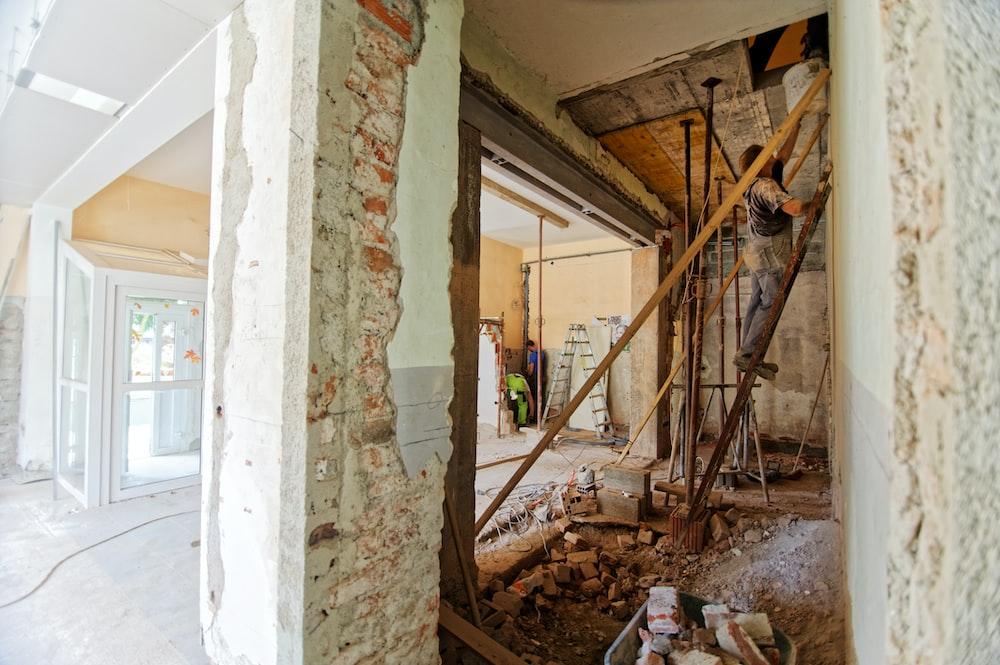 man climbing on ladder inside room