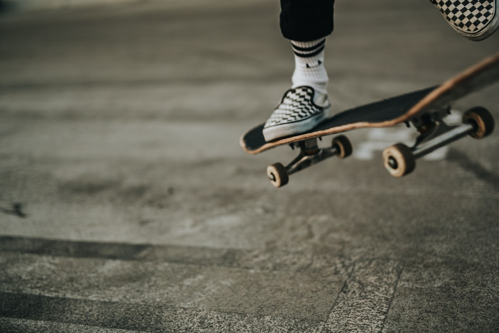 person jumping with skateboard