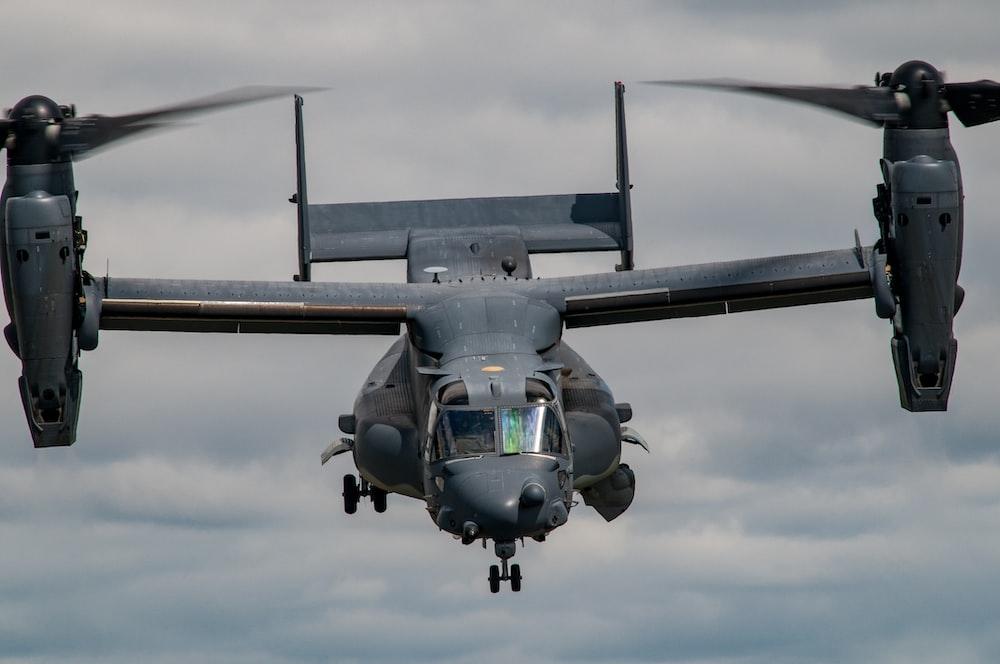 black helicopter carrier hovering on sky