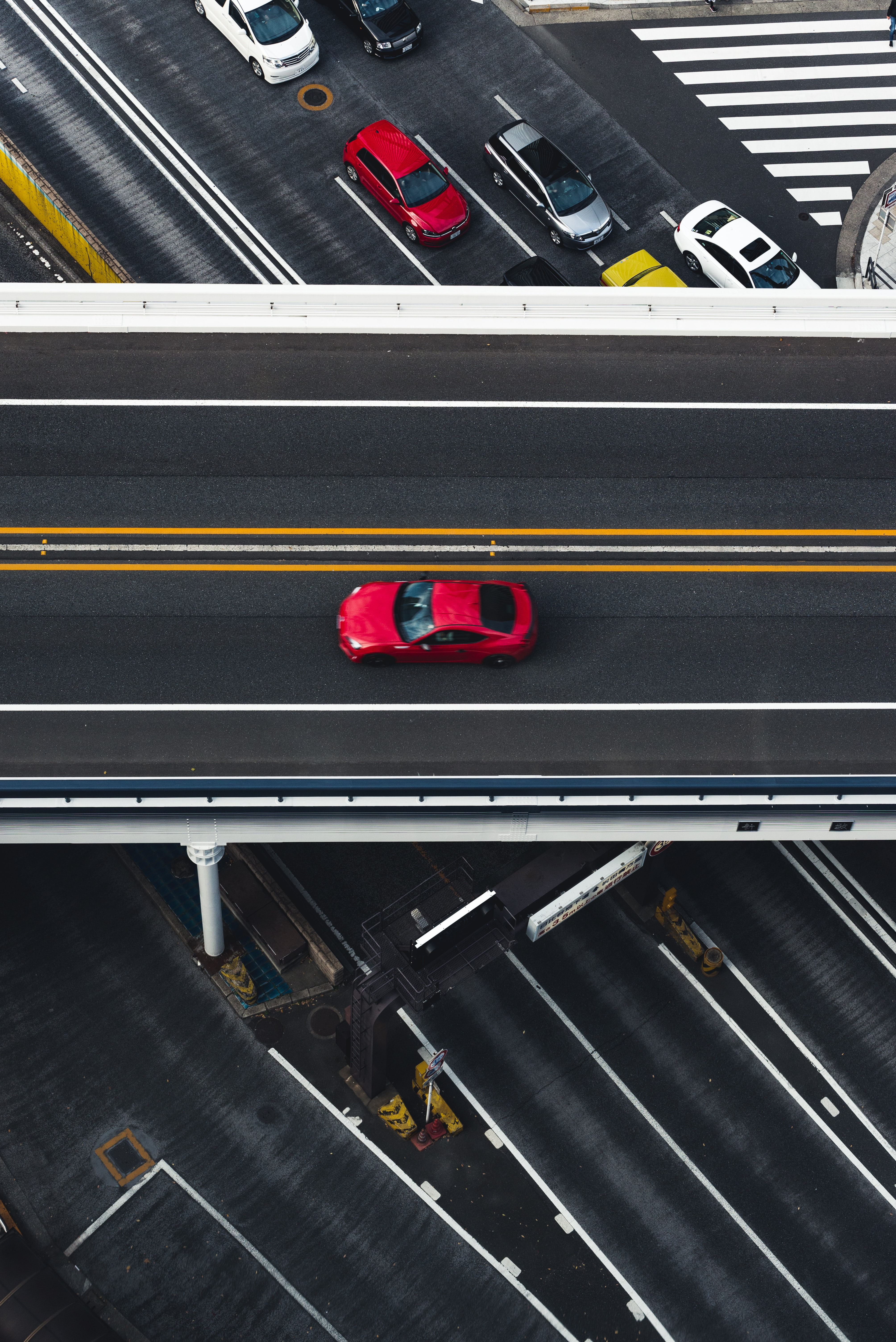 red car on super highway aerial photography