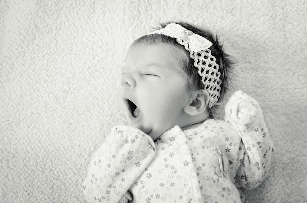 baby wearing sleeper suit