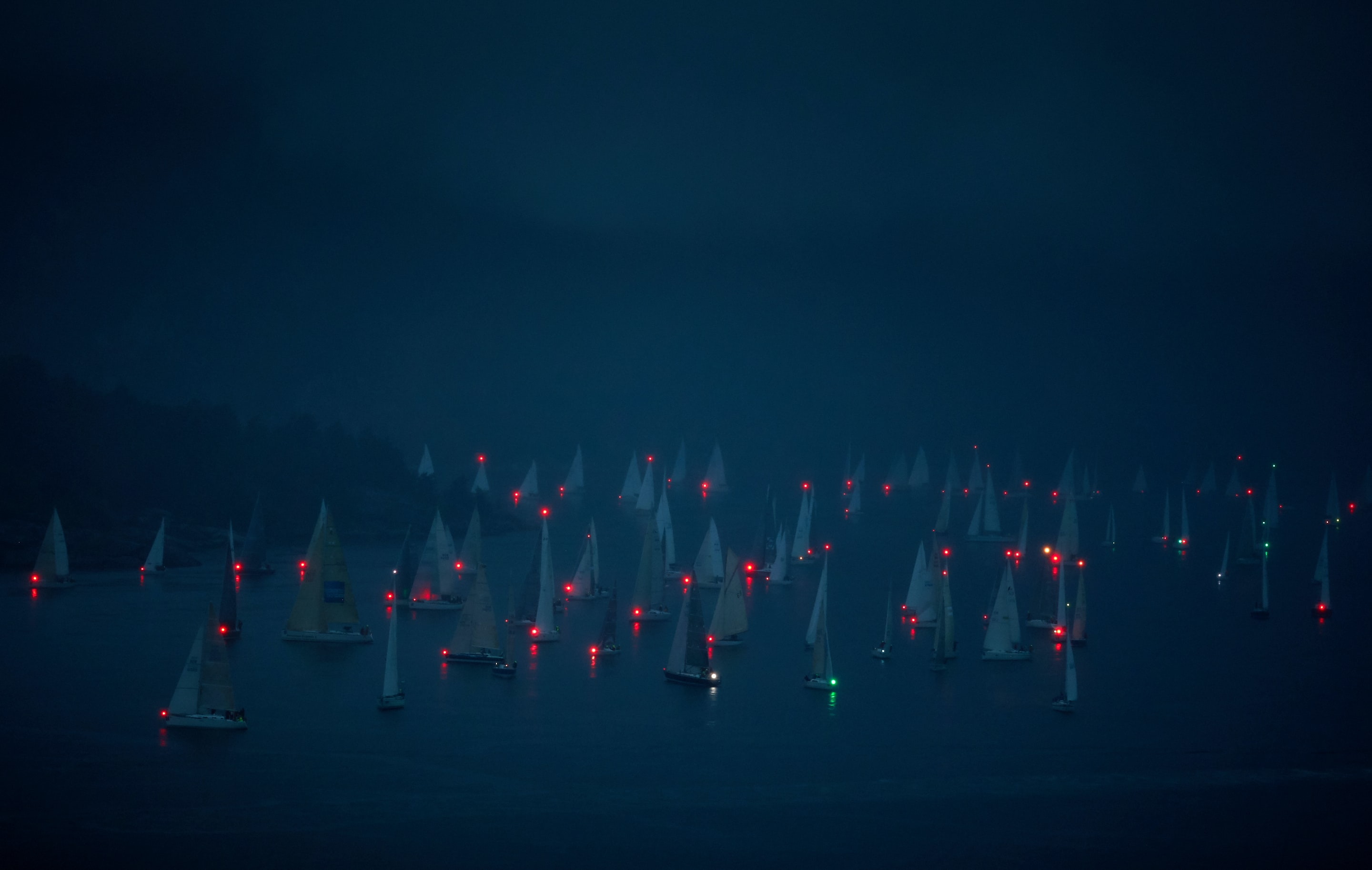 boats on body of water during night