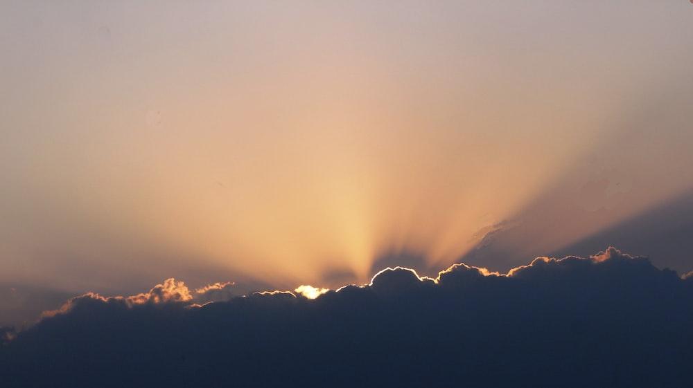 sunlight across black clouds