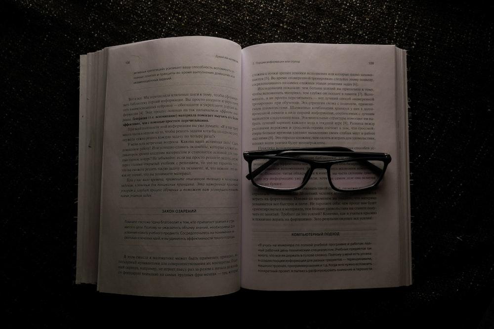 eyeglasses on white book
