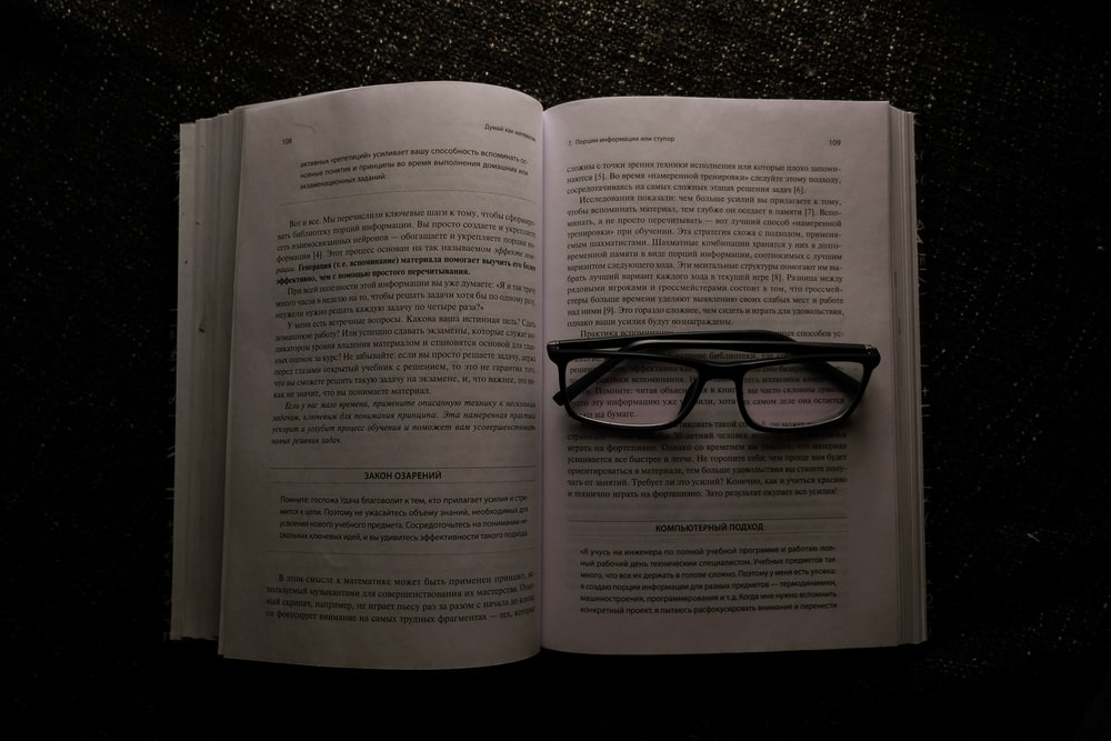 eyeglasses on white book
