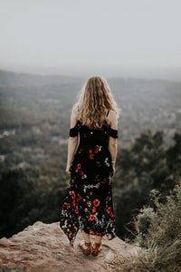 woman standing near the cliff