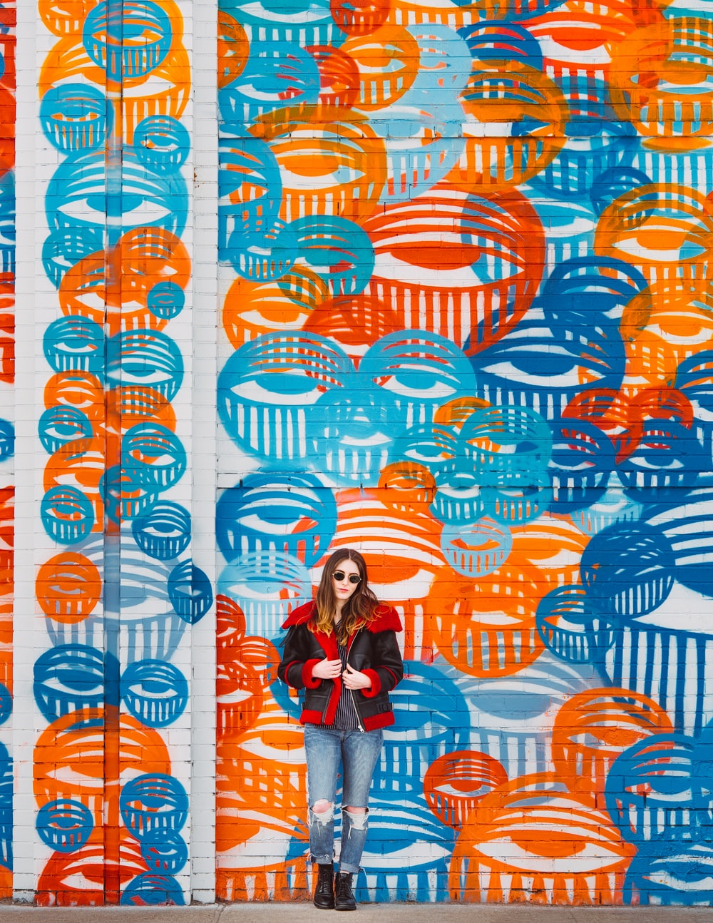 woman standing beside on wall street art