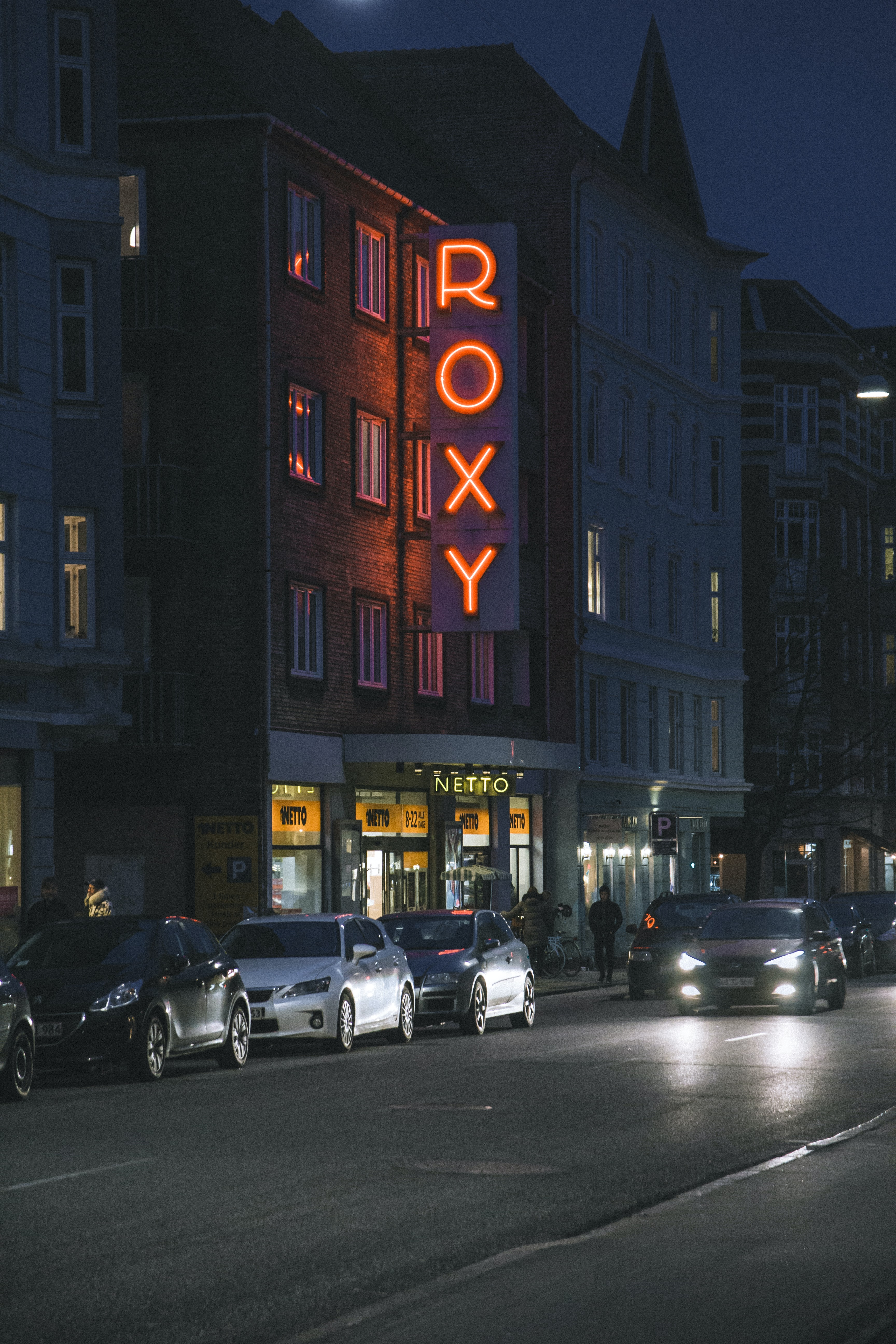 vehicles in front of Roxy establishment during nighttime
