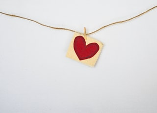 heart-shaped red and beige pendant