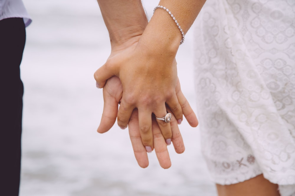 couple holding each hands