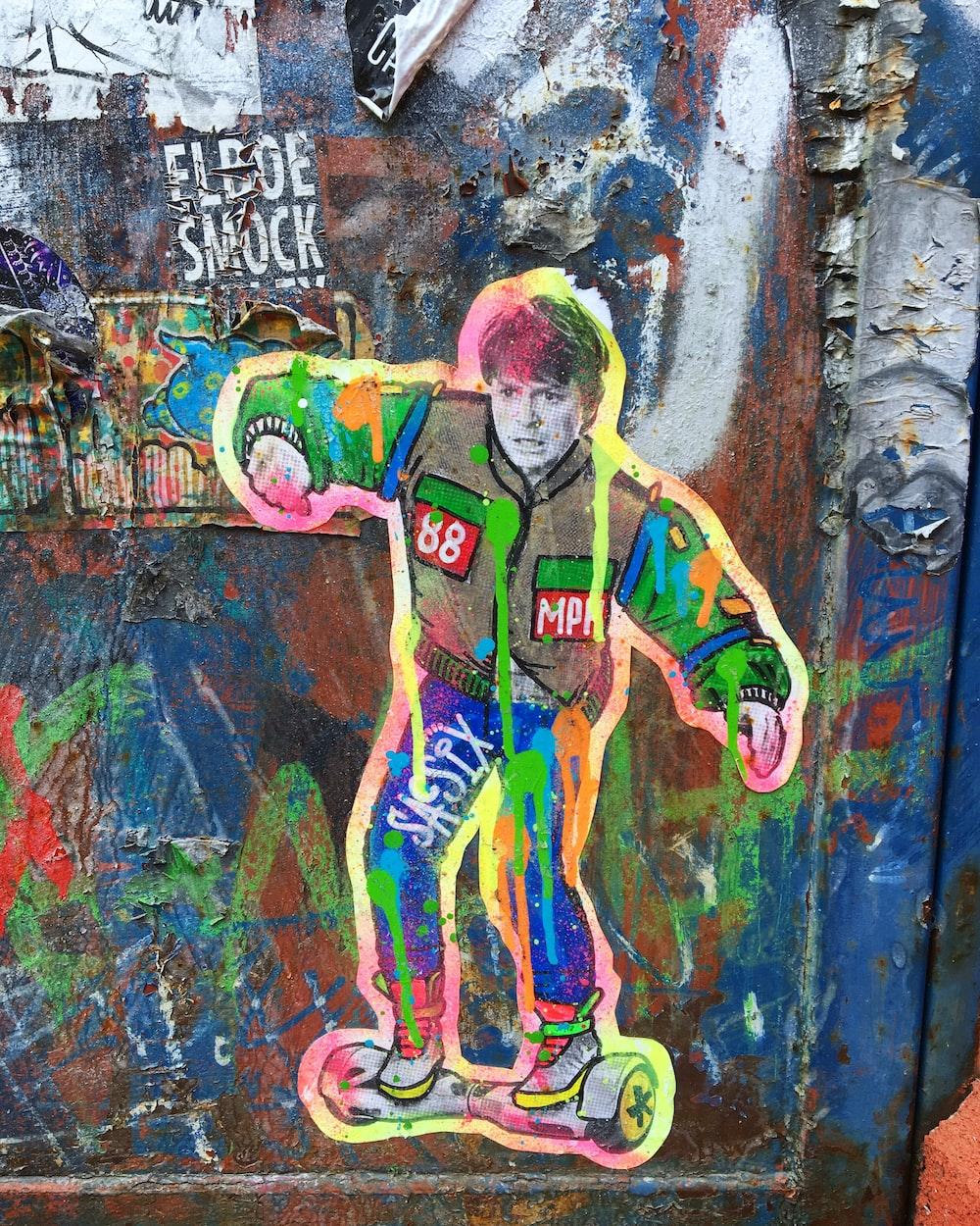 man riding on self balancing board graffiti