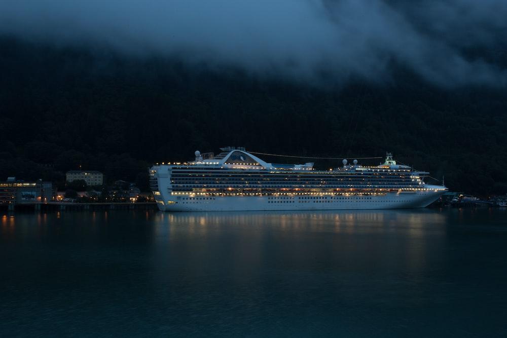 photo of white cruise ship during nighttime
