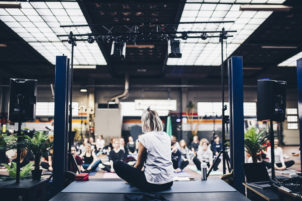 woman sitting in the yoga mat