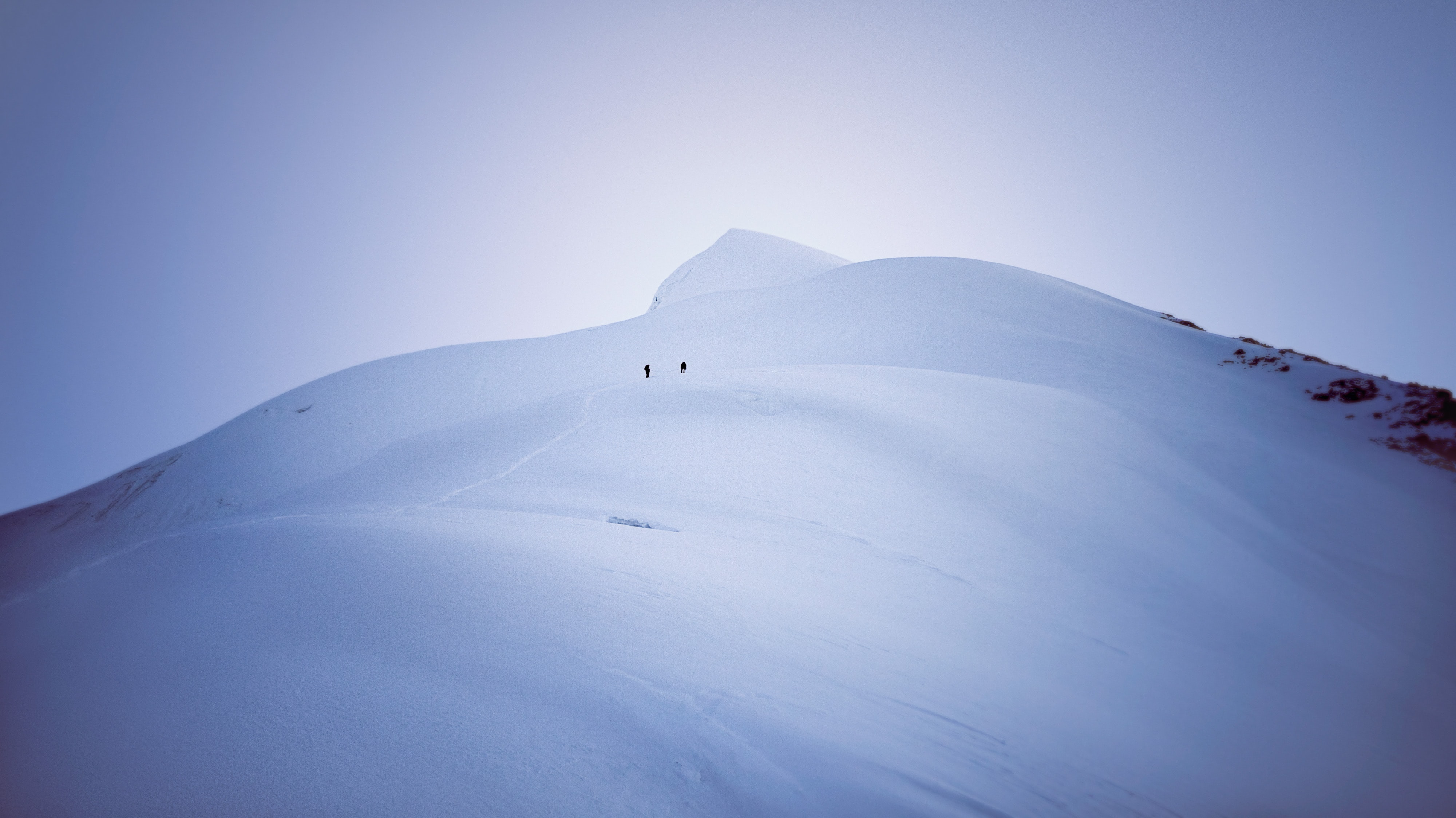 person on white snow covered mountain