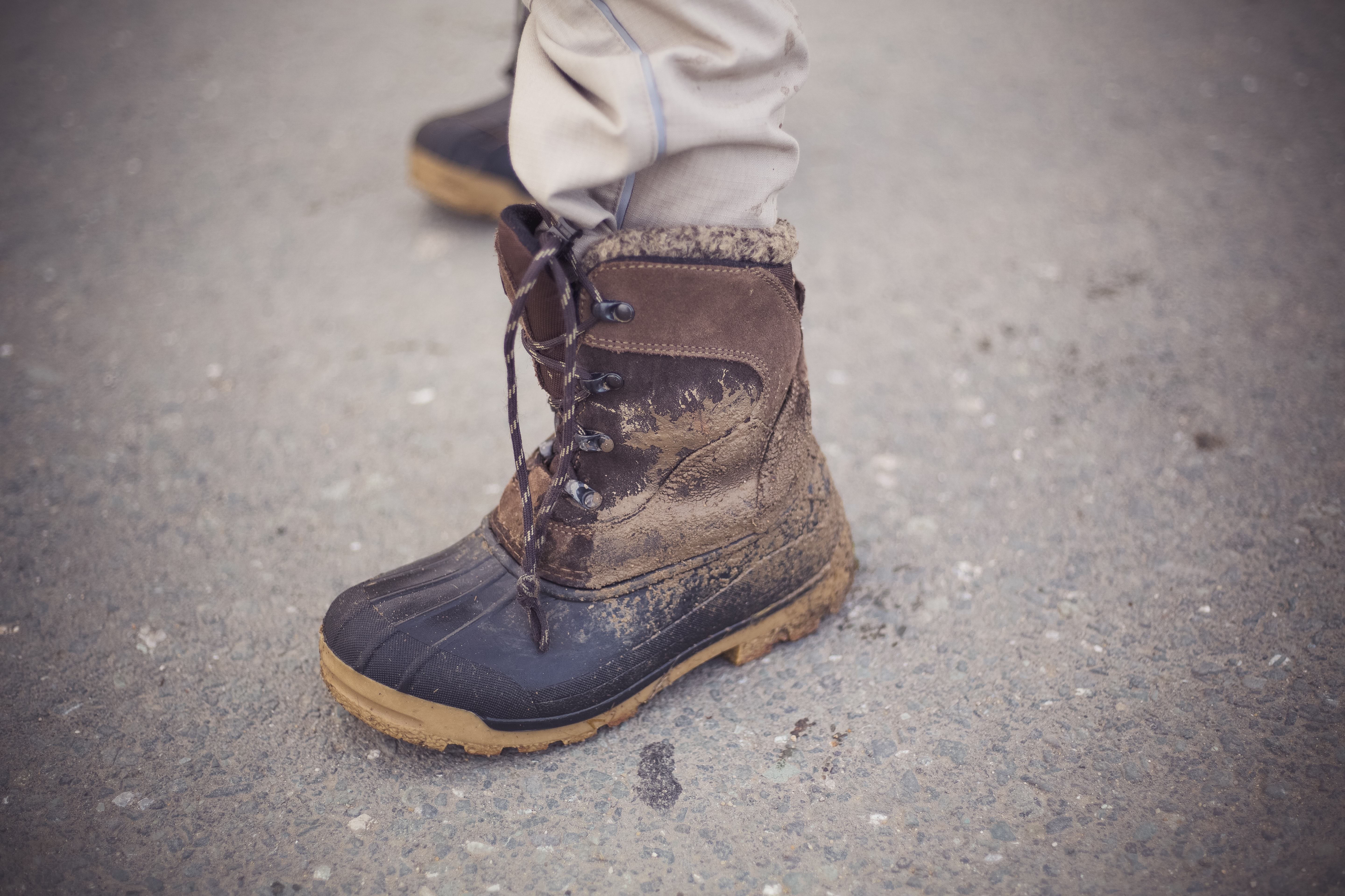 person wearing brown boot