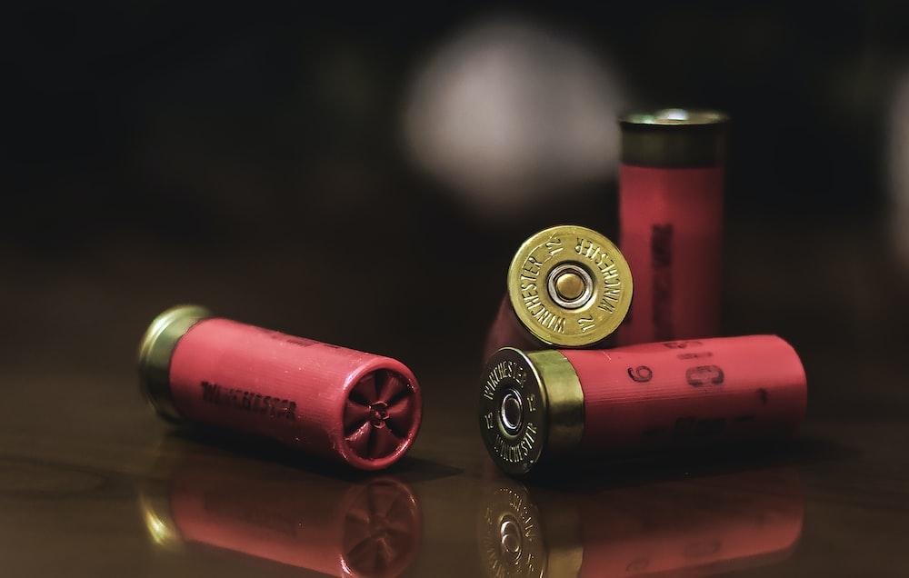 red and gold shotgun shells
