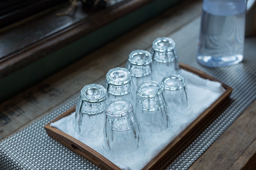 seven clear cut-glass drinking cups