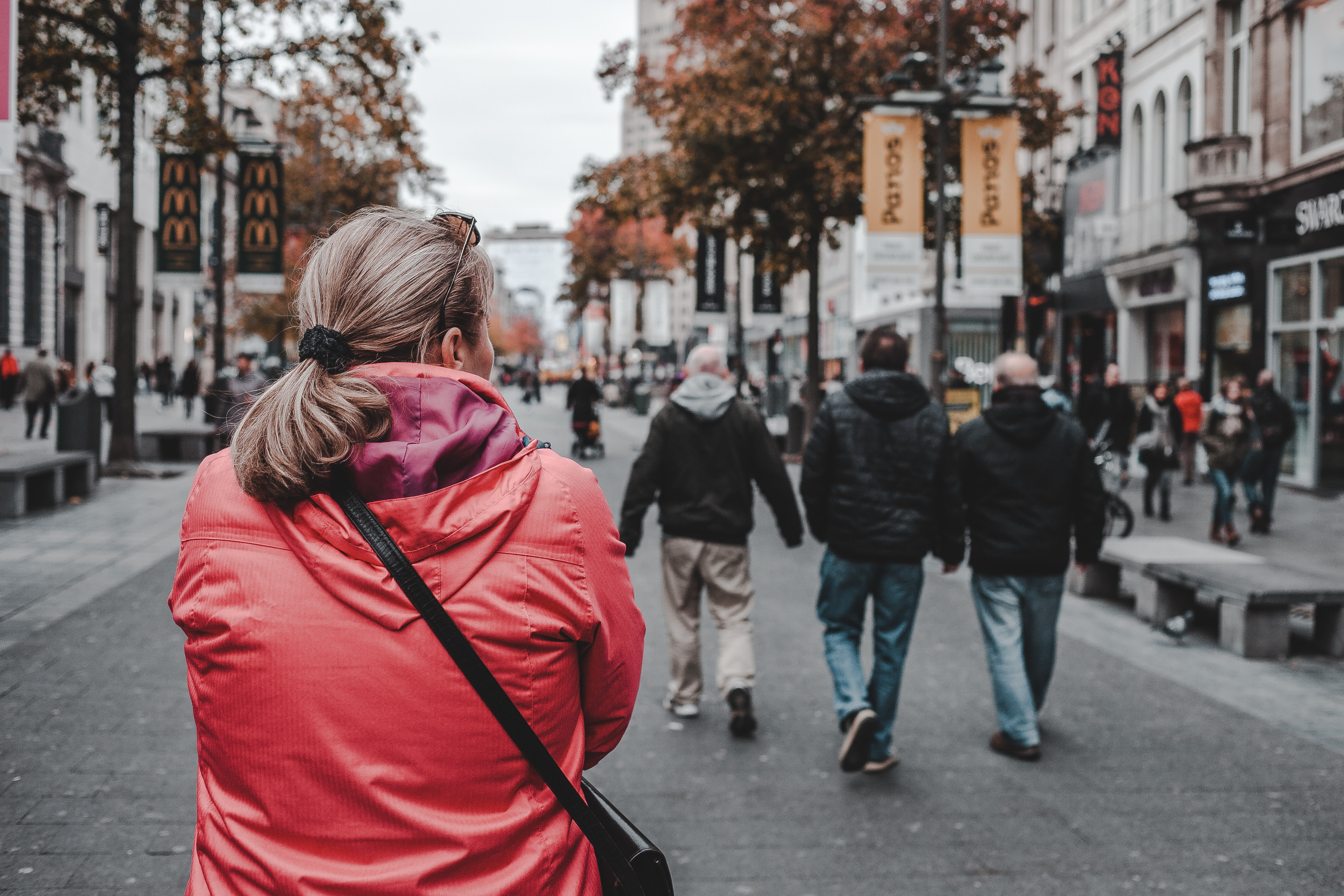 woman walking while looking right side