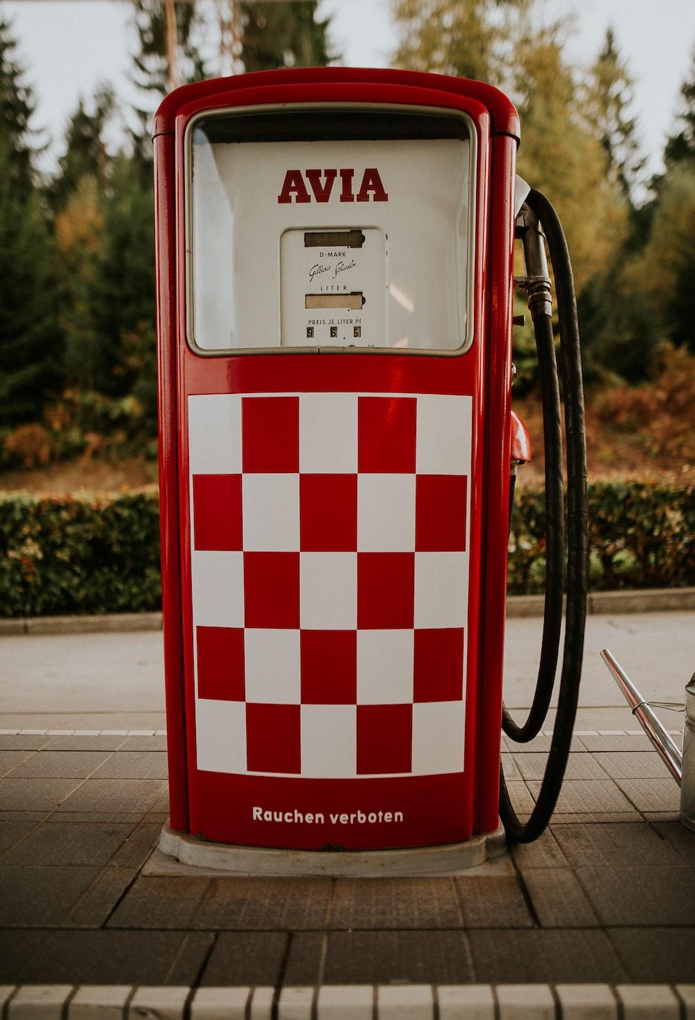 red and white Avia gasoline machine