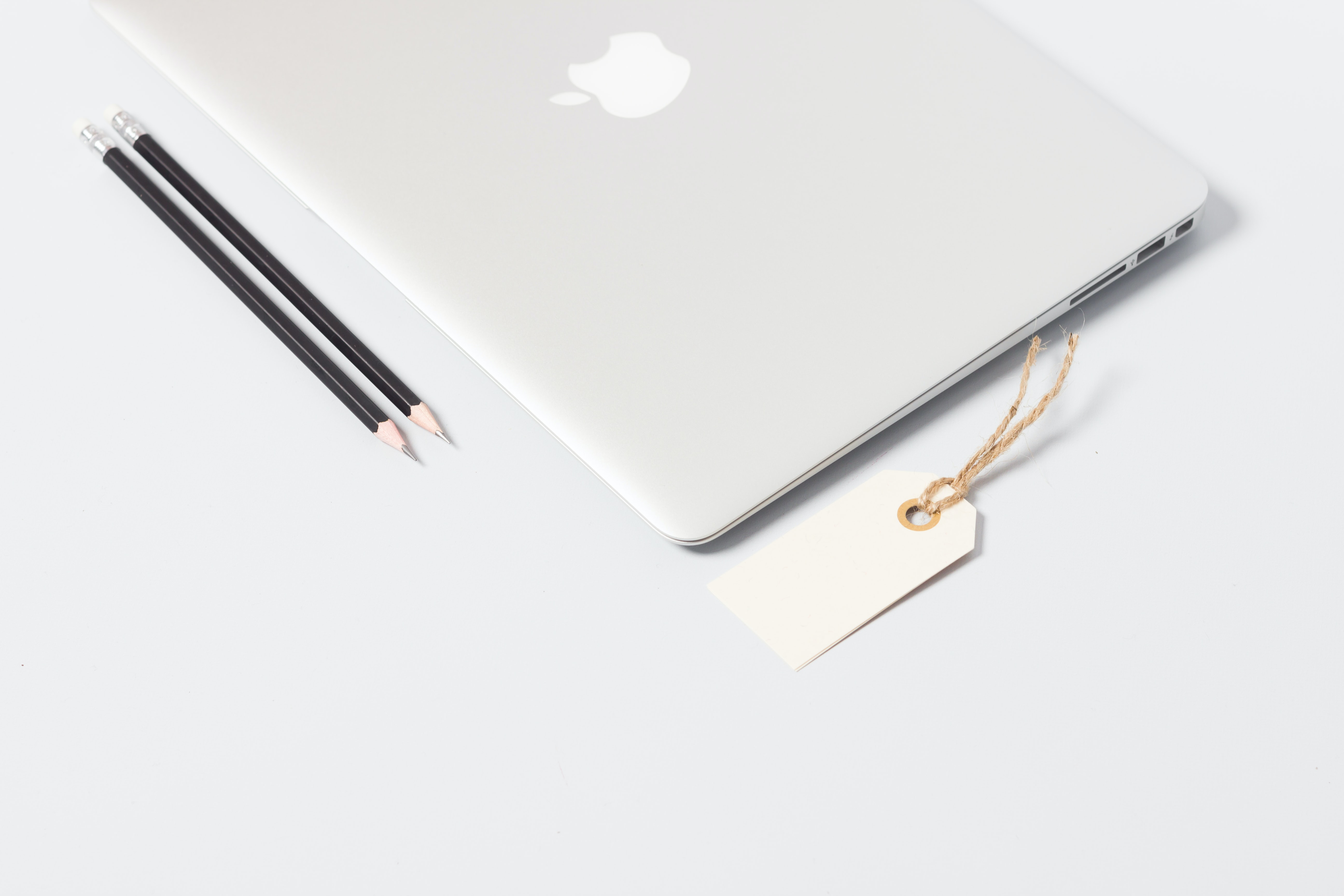 closeup photo of MacBook Air near pencils