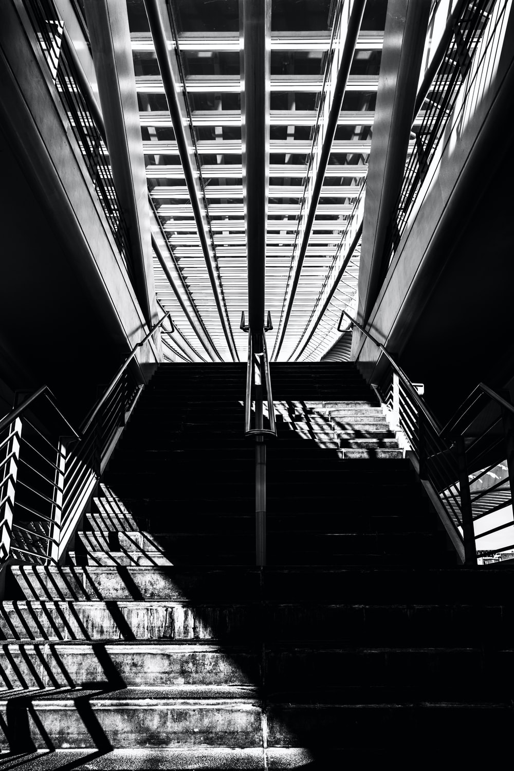 grayscale photography of station stairs