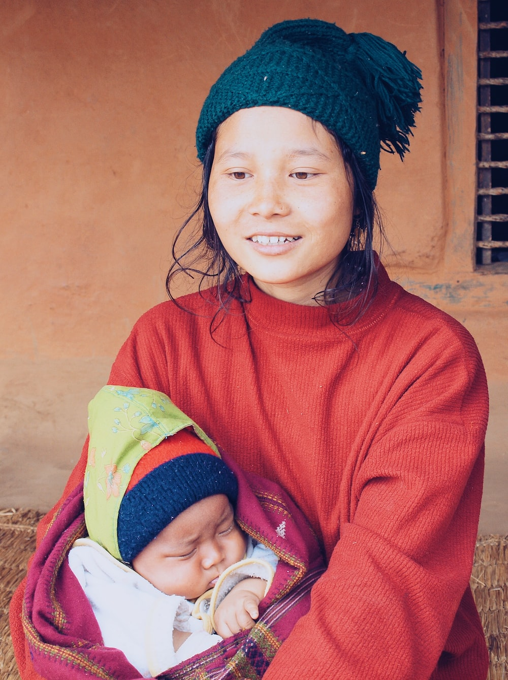 woman carrying a baby