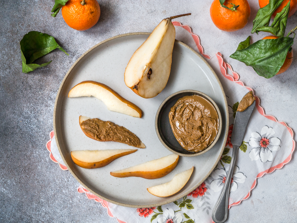 pear and peanut butter on plate