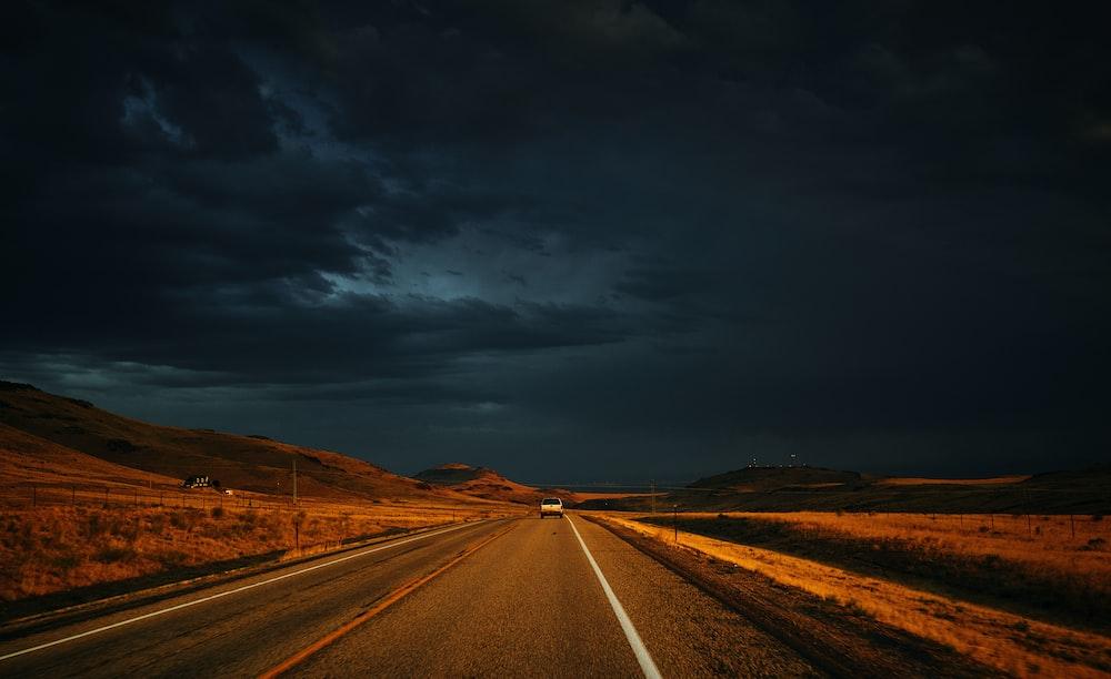 photo of road towards mountain