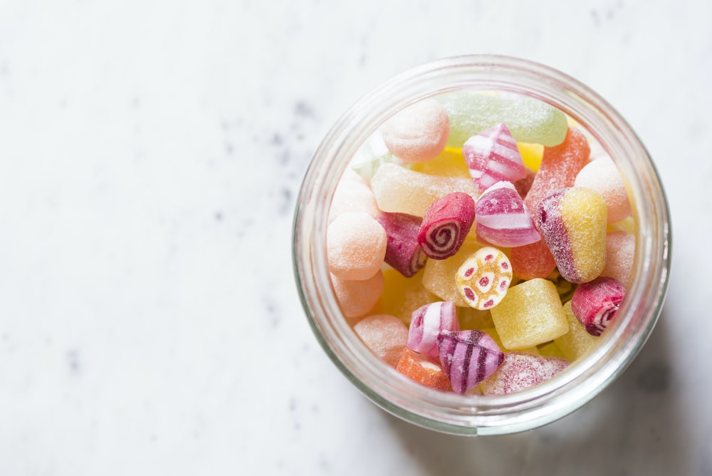 assorted-color candies on container
