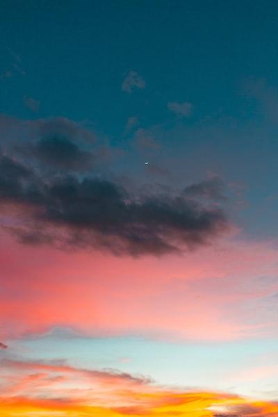 moon near gray and blue sky