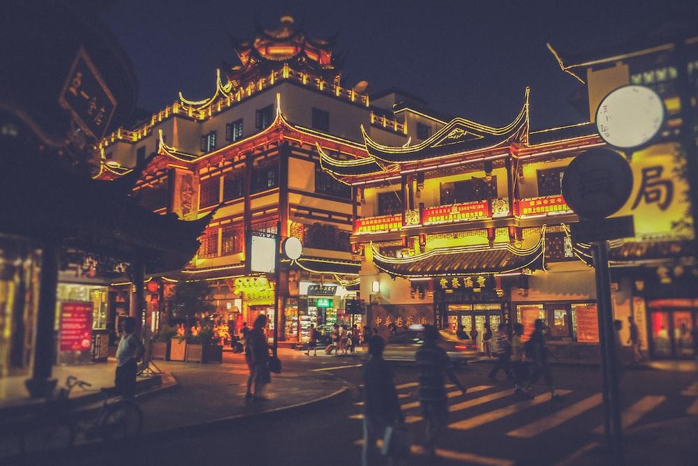people walking on street near buildings during nighttime