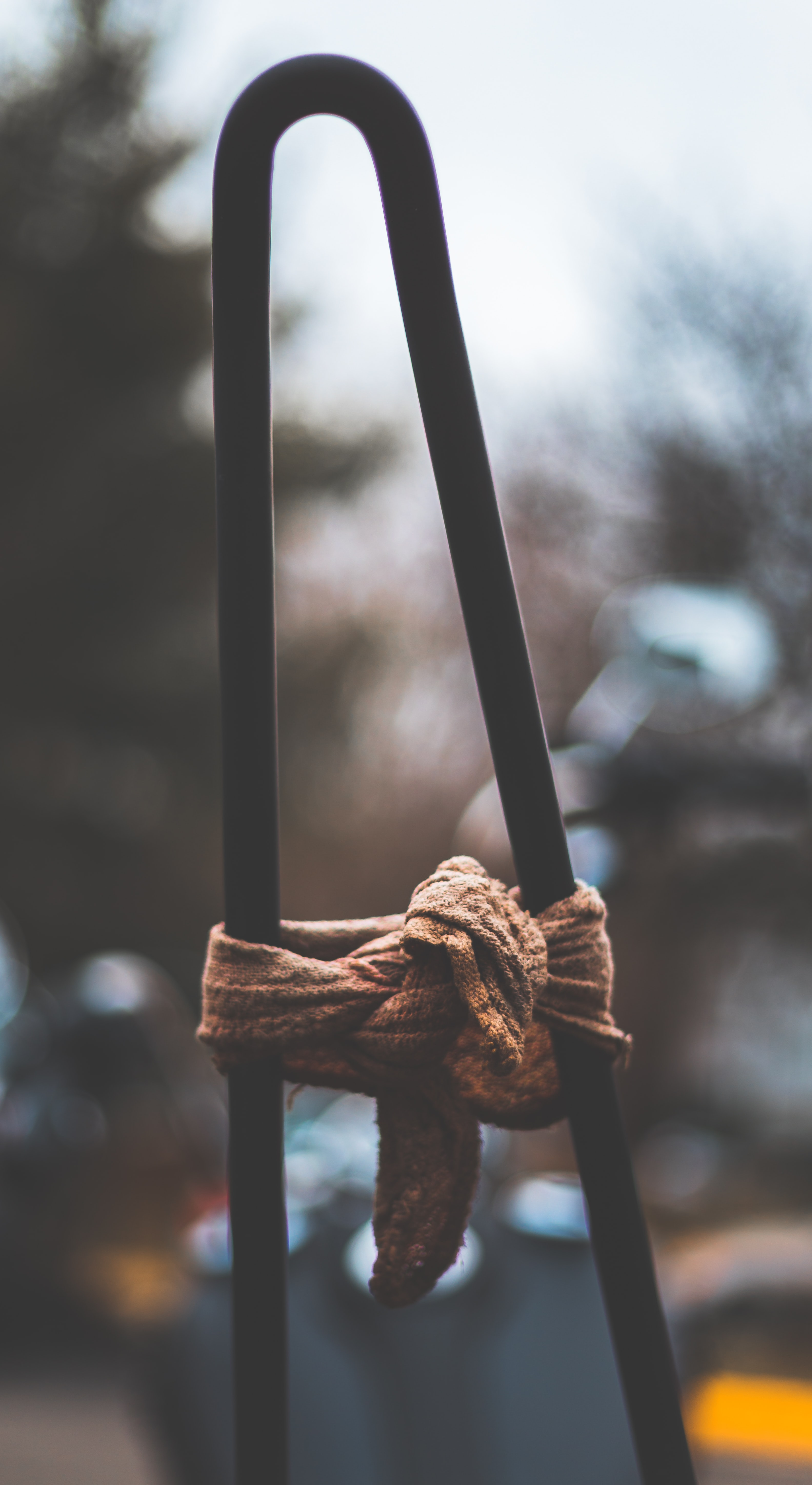 black rod with brown tied cloth