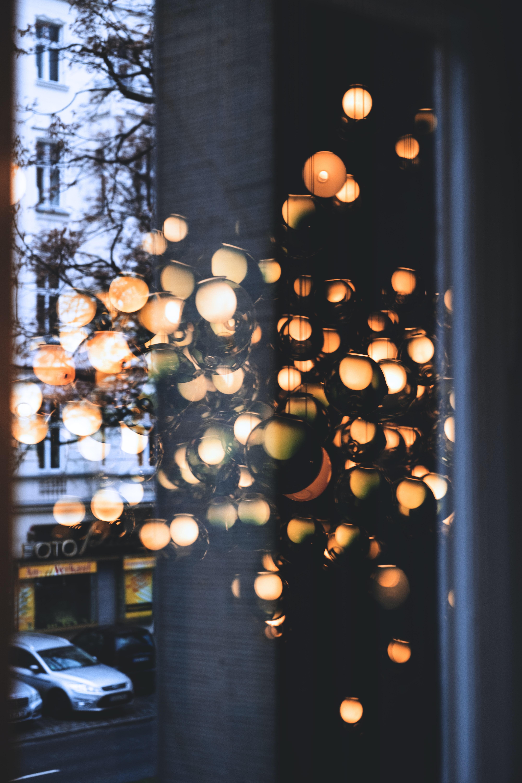 orange light bulbs turned on inside glass room