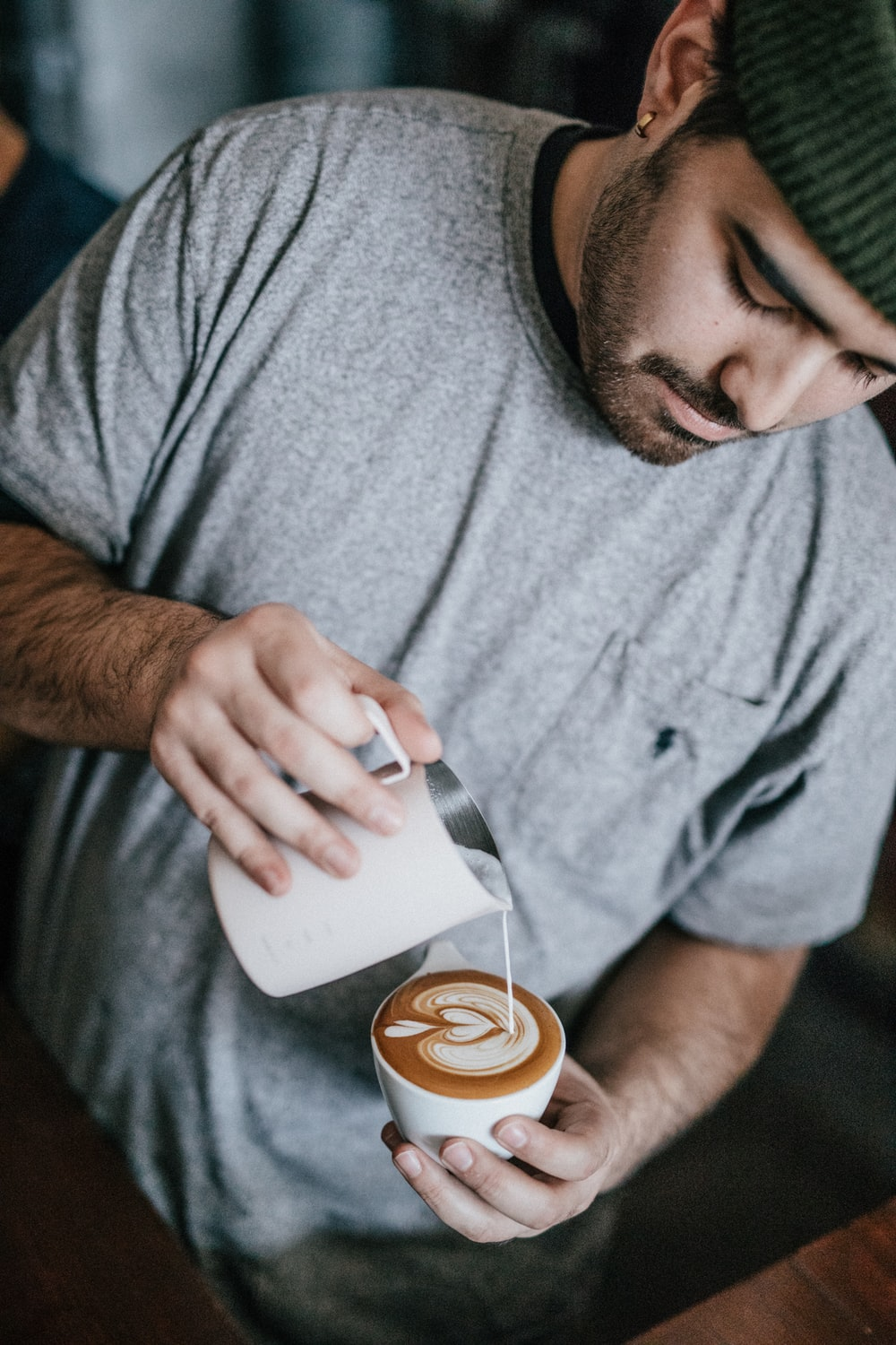 man in gray crew-neck T-shirt making cappuccino