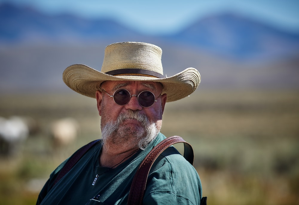 shallow focus of man wearing sunhat