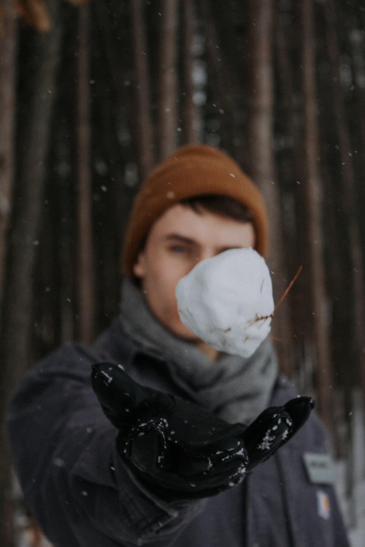 man holding snow ball