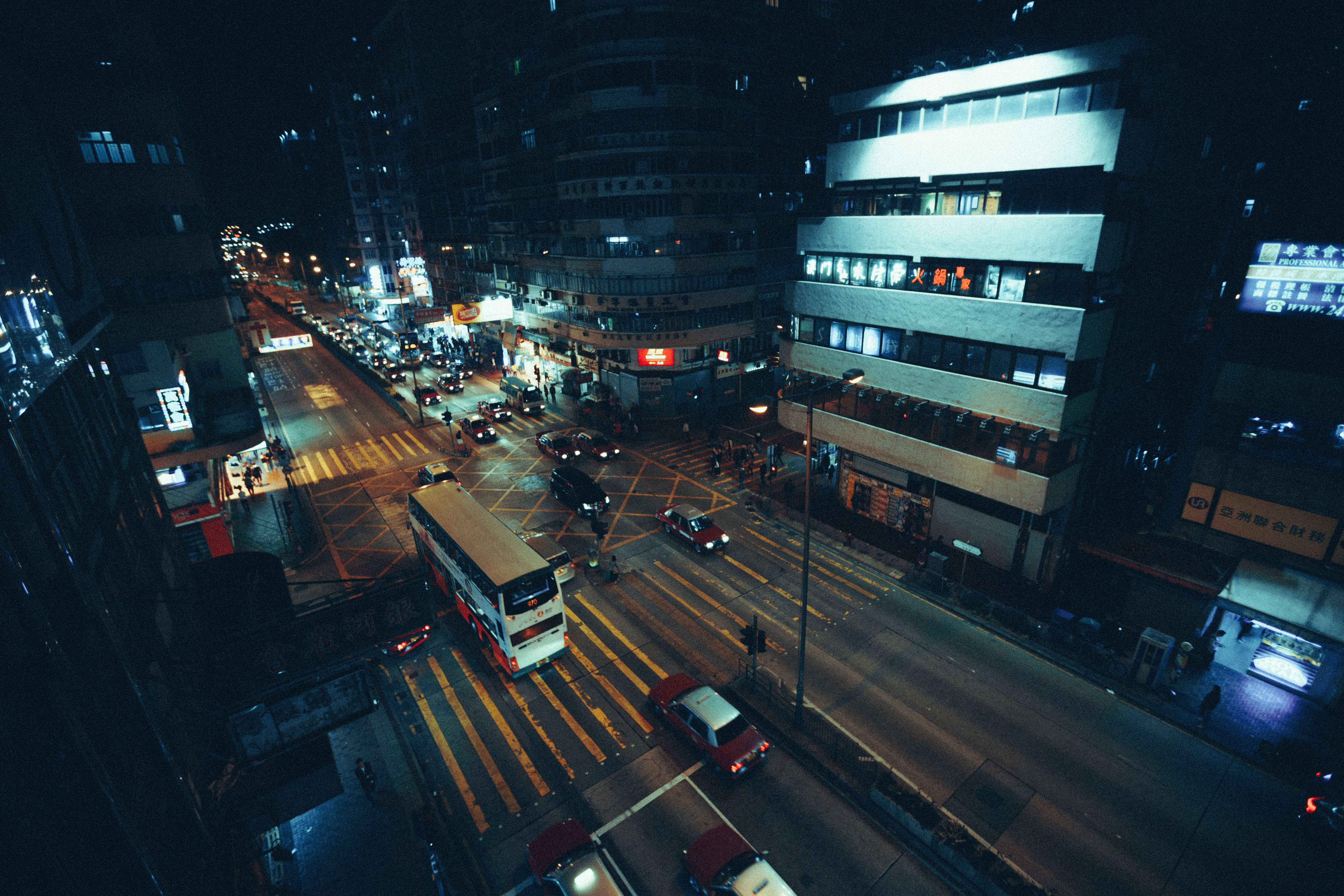 photo of white bus on road during nighttime