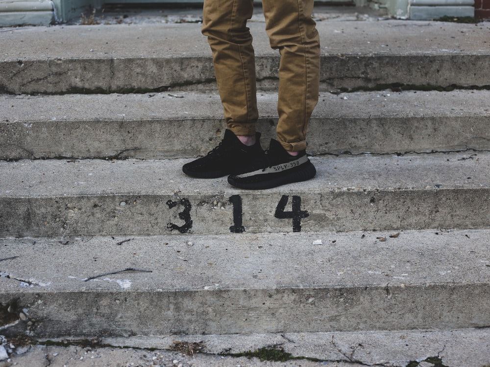 men's pair of black adidas shoes