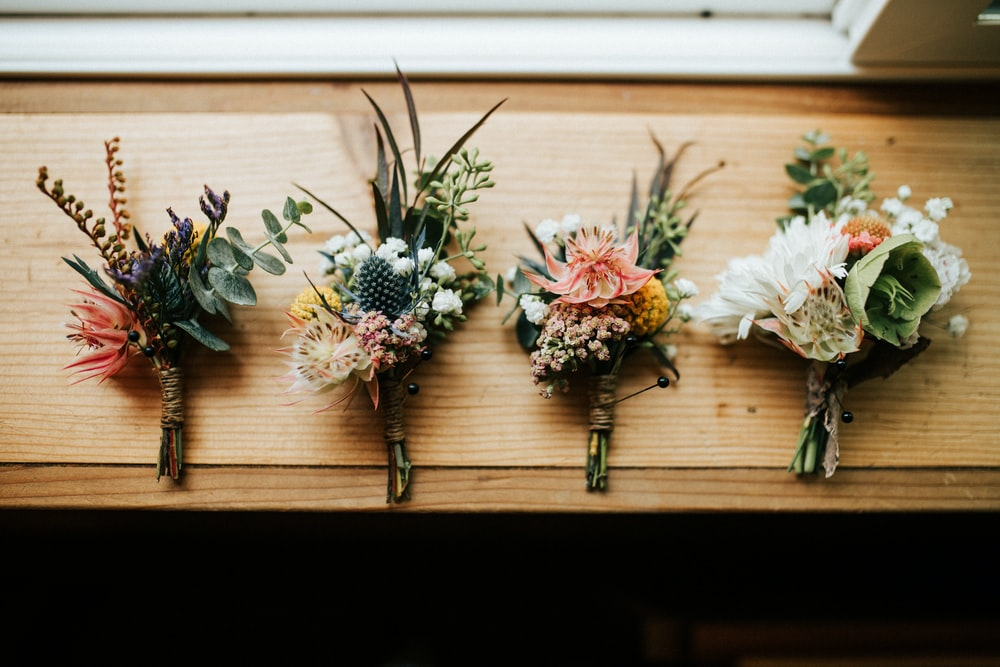 three flower bouquets on table