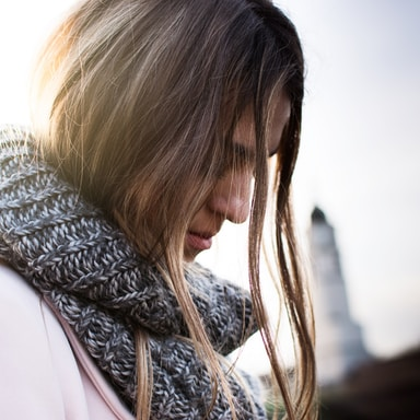 woman wearing gray and black scarf