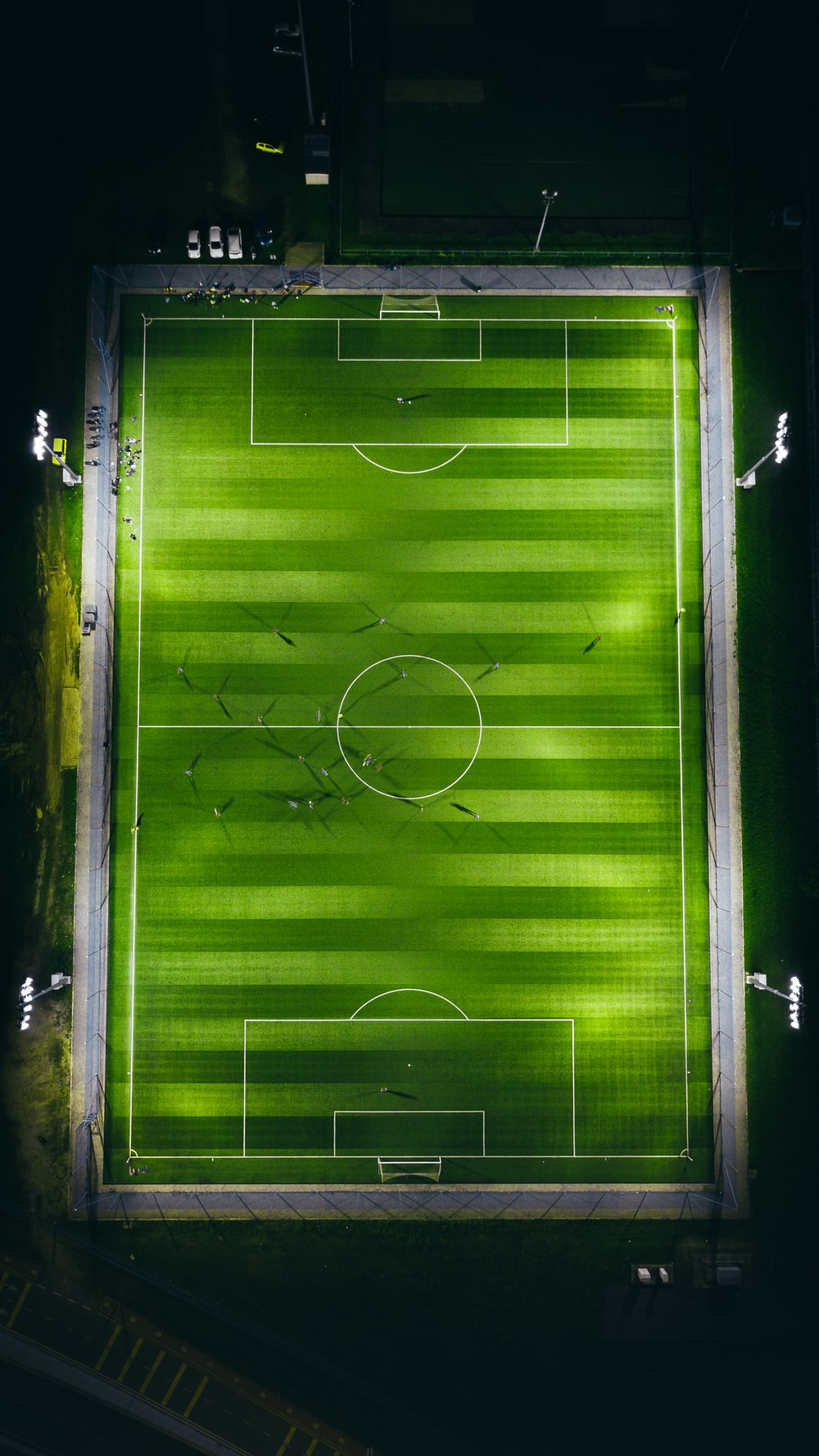 bird's-eye view photography of green soccer field with lights
